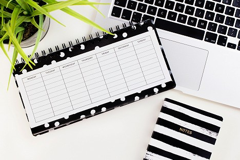 Calendar with notebook and laptop