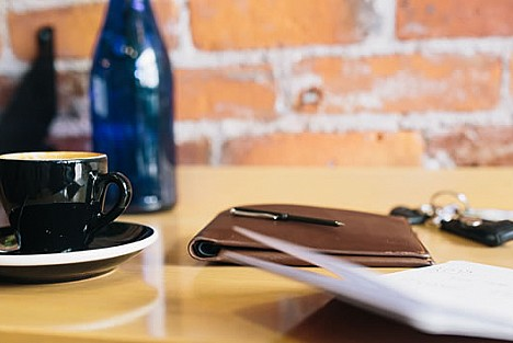 Coffee cup and notebook